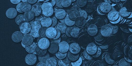 A photo of pennies in a pile tinted blue