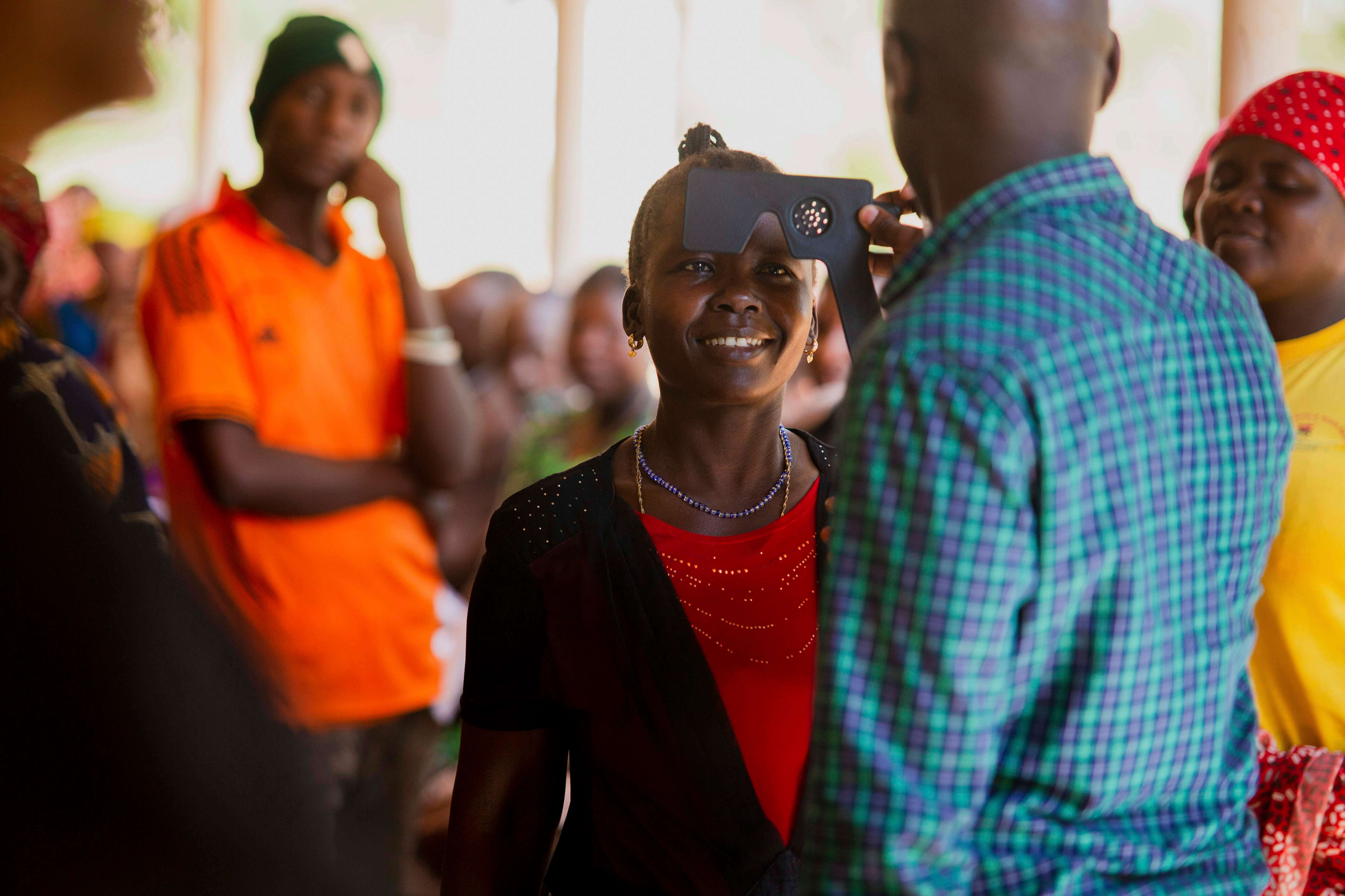 Tanzanian female teenager getting her eyes examined.