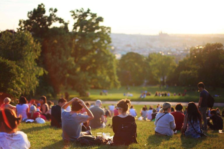 A crowd of people sitting in a park