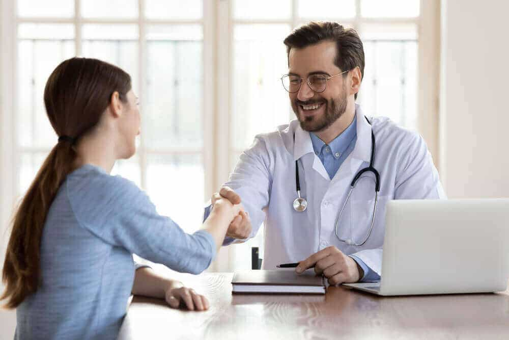 happy physician greeting patient