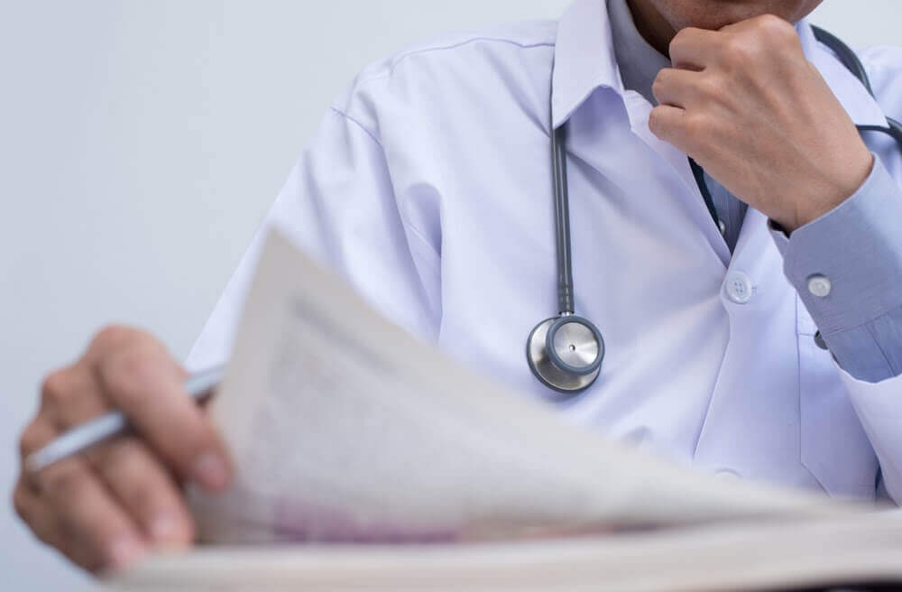 Doctor reviewing contract