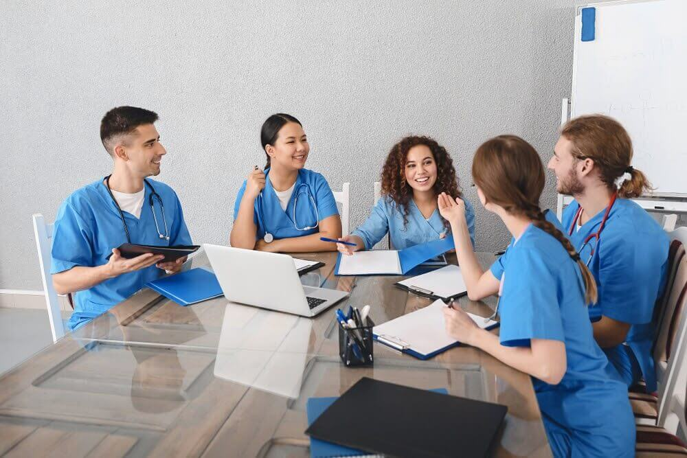 Doctors talking around a table