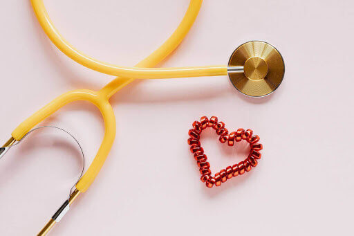 Yellow stethoscope on table