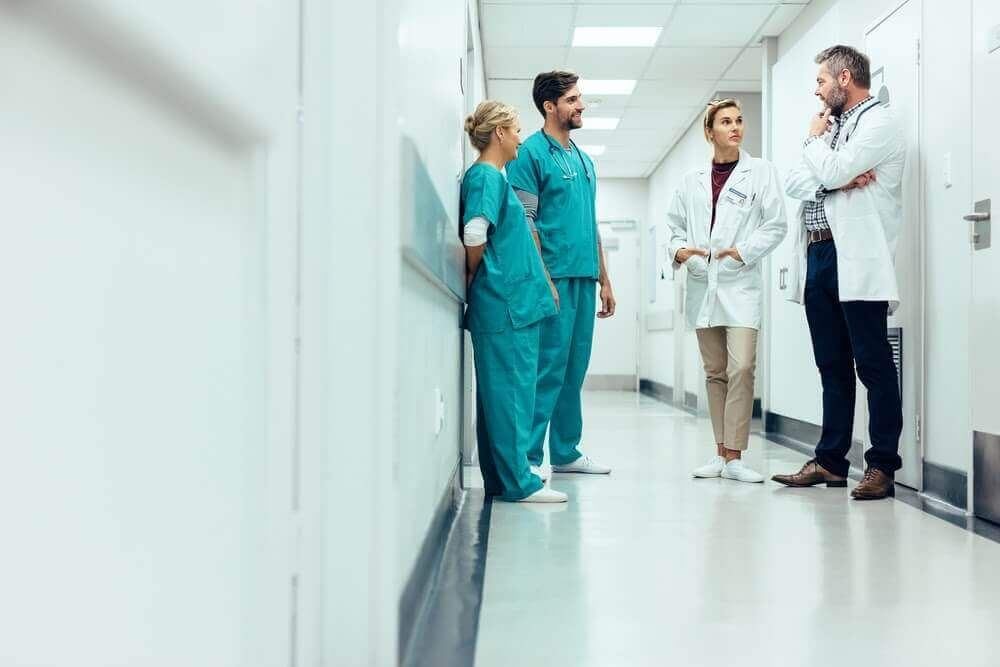 Physicians standing in a hallway