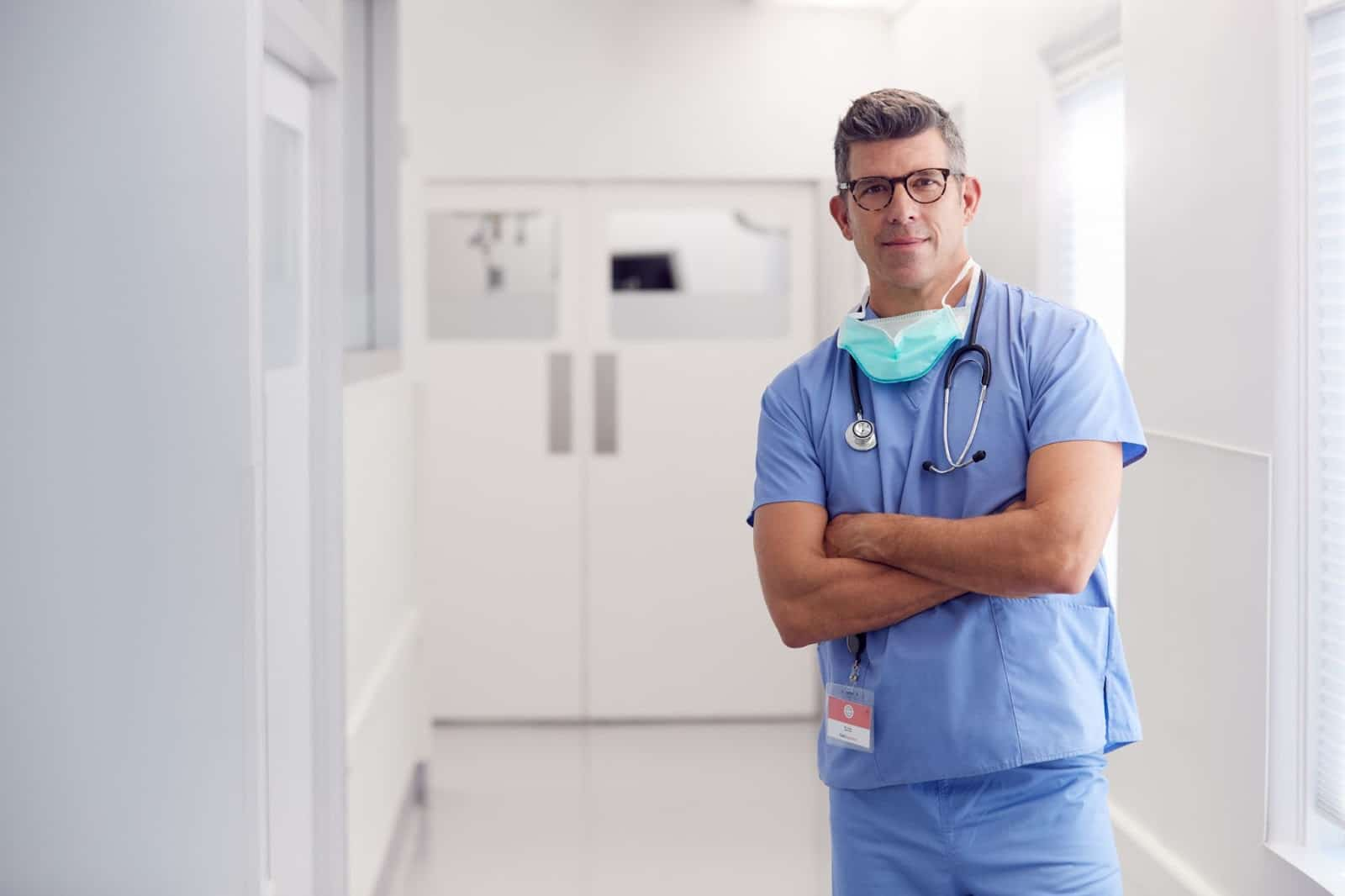 Surgeon standing in hospital hallway